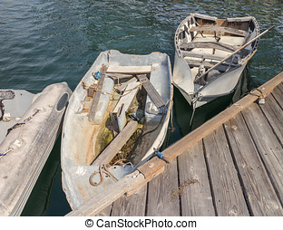 Old small boats at wood dock - Top view of weathered and...