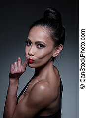 Close up Young Fit Woman in Hushing Gesture