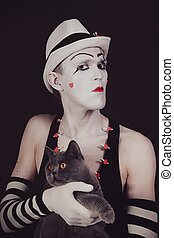 mime with a gray British cat - Portrait of the mime with a...