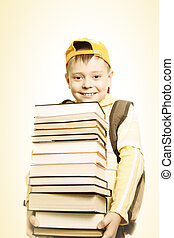 Smiling schoolboy with books - Smiling schoolboy in yellow...