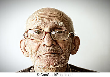 Senior man in eyeglasses - Closeup face portrait of senior...