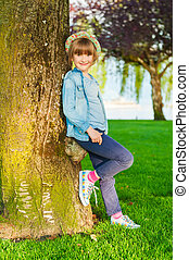 Summer portrait of a cute little girl of 6 years old,...