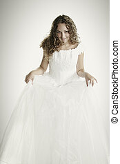 Bride raising dress skirt - Pretty young fair-haired curly...