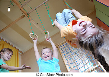 children playing at home - three happy 5 year old children...