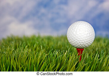 golf ball on red tee - Close up of a white golf ball on a...