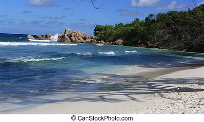 Panorama of beautiful beach Anse Cocos. Island of La Digue...