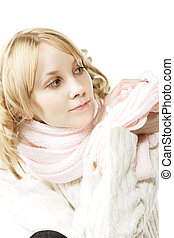 Blonde in pink looking aside - Pretty young blonde woman in...