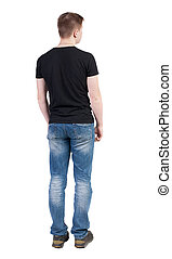 Back view of man in jeans. Standing young guy.