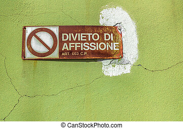No advetising - An old sign forbidding consumed by rust.
