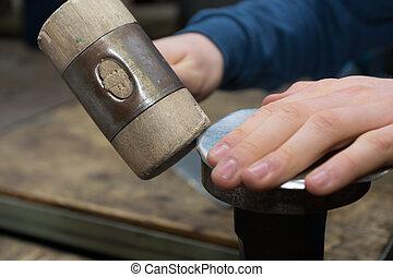 Sheet is folded by craftsmen - Blech wird von Handwerker mit...