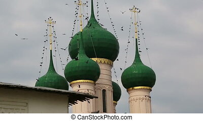 birds over domes in Rostov the Great, Russia - Many birds...