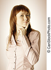 Consideration - Pretty young redhead woman considering...