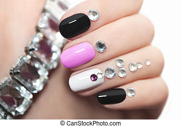 Manicure with rhinestones. - Colorful manicure oval shape...