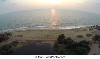 flying from beach resort over sea at sunset - flying from...