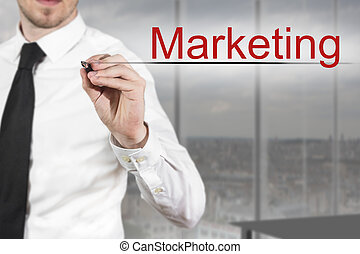 businessman writing marketing in the air