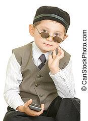 Serene boy in black cap over white background