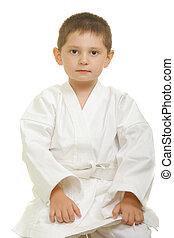 karate, niño, Sentado, rodillas