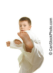 Stright kick - Karate boy making stright kick against white...
