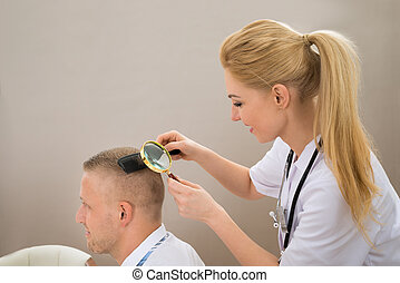 Female Dermatologist Looking Hair Through Magnifying Glass -...
