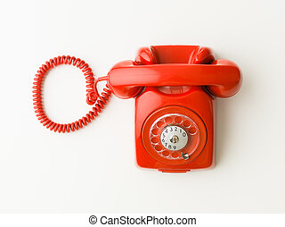 contact us - top view of red vintage phone on white...