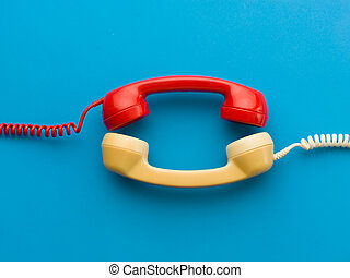 interesting conversation - two handsets facing each other on...