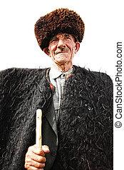 Stately herdsman - Stately elderly herdsman in traditional...