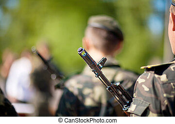Soldiers with assault rifles - Soldiers with a submachine...