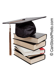 Graduation cap on top of a stack of books on white