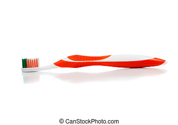 Orange toothbrush on white