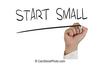 Start Small - Business concept image of a hand holding...