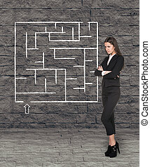 Young businesswoman looking at the labyrinth