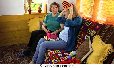women size caps - Grandmother with pregnant granddaughter...