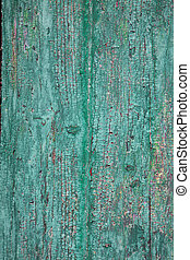 peeling paint over wooden surface, with cracks and different...