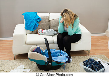 Post Natal Depression - Stressed Mother With The Baby...