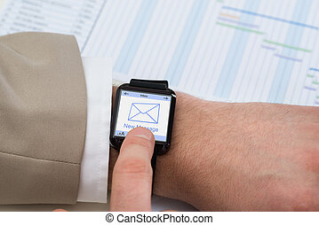 Hand With Smartwatch Showing Unread Message - Close-up...