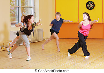 Stretching out forward in group aerobics