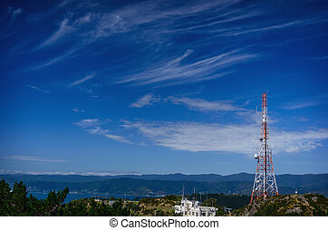 Tele-radio tower. - Red and white tele-radio tower against a...