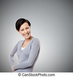 Cheerful young woman, on grey background