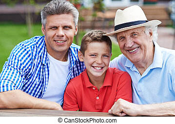 Men of one family - Happy senior man, young man and boy...