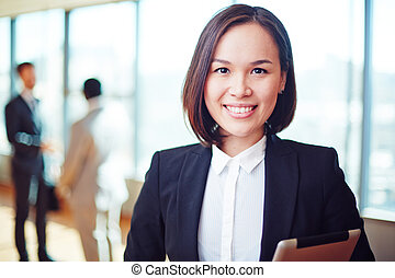 Pretty leader - Female business leader looking at camera