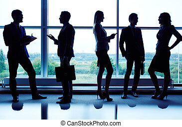 Silhouettes of business team - Several business partners...