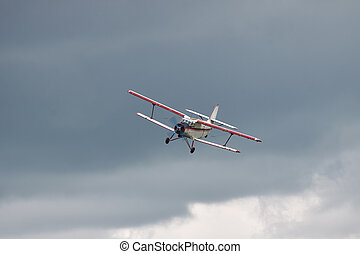 Old biplane landing