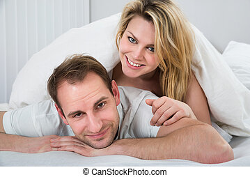 Woman Lying On Back Of Man