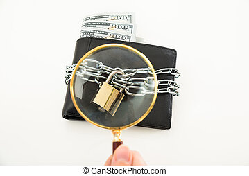 Person Hand With Magnifying Glass Over Wallet - Close-up Of...