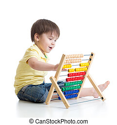 Child playing with abacus toy
