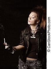 Cigarrillo, ardiendo fuego lento