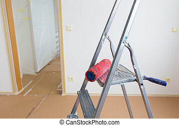 home renovation - Ladder and red roller, home renovation