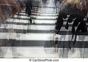 People crossing a road, hurrying, blurred motion