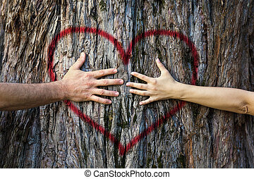 Couple touching heart - Hands of couple in love hugging a...