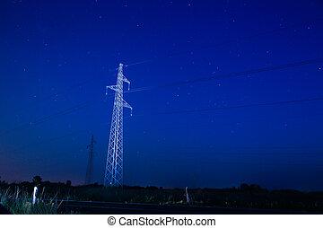 Pylon under starry sky